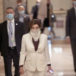 Republicans refuse to wear coronavirus masks, angering Democrats