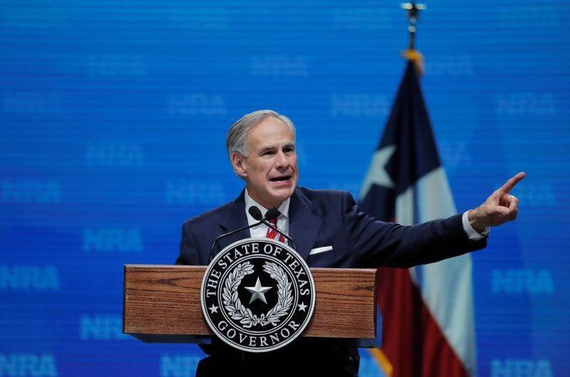 Texas, at center of new U.S. coronavirus surge, pauses reopening