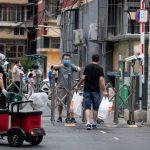 Coronavirus' return to Beijing disrupts life and rattles nerves