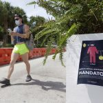 Florida's new coronavirus cases break record, nearly tying New York's peak