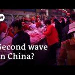 Dozens of new coronavirus cases tracked to Beijing food market | DW News